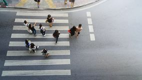 People walk and watch on crosswalk street. At the top view of city street. aerial view stock images