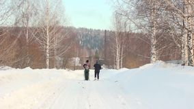 People walk in the winter woods. Two women stock footage