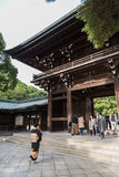 People walk through Wooden shrine Meiji Shinto in Shibuya Japan. 1 stock images