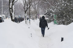People are walking on the street after massive snowfall Stock Photo