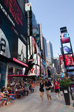 People walkin in Times Square, a symbol of New York City Royalty Free Stock Photos
