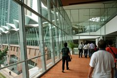 People walking,. Kuala Lumpur Convention Center royalty free stock image