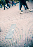 People walking. On the street, motion blur stock photography