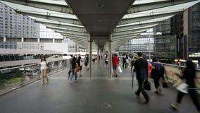 People walking across an elevated walkway in central Hong Kong Island stock video footage