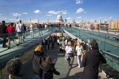 People walking across a footbridge Millennium Bridge Stock Photos