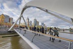 People walking across the Southgate footbridge in Melbourne Stock Images