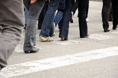 People walking across the street. In Barcelona, Spain Royalty Free Stock Photo