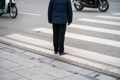 People walking across a street in Hanoi, Vietnam. Closeup.  Royalty Free Stock Photos