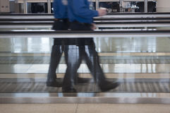 People walking through airport Stock Image