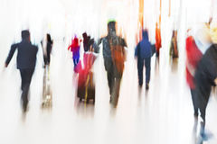 People Walking at Airport in Motion Blur. People Rushing at Airport in Motion Blur Royalty Free Stock Images