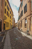 People walking by alley in the historic center of Ferrara. Stock Image