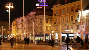 People walking along Ban Jelacic Square in Zagreb stock footage