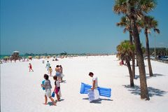 People walking along beach. In Clearwater, Florida Royalty Free Stock Images
