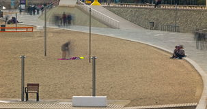 People walking along the beach.Time Lapse 4K - Wake effect.01 stock footage