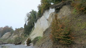 People walking along the chalk rock cliff of Rugen island in autumn time stock video footage