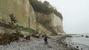 People walking along the chalk rock cliff of Rugen island in autumn time stock footage