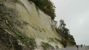 People walking along the chalk rock cliff of Rugen island in autumn time stock video