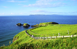 People Walking Along the Coastline Footpath to Carrick-a-Rede Rope Bridge Stock Photos