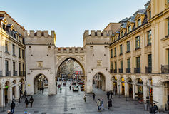 People walking along through the Karlstor gate Royalty Free Stock Images