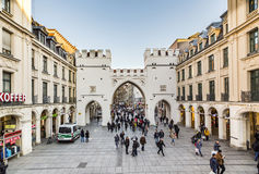 People walking along through the Karlstor gate in Munich Royalty Free Stock Photos