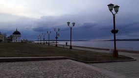People walking along lake quay when sunset stock footage