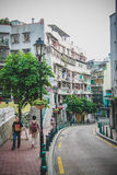 People are walking along the narrow road in Macau Royalty Free Stock Photo