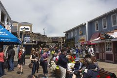 People walking along Pier 39 dock in San Francisco Royalty Free Stock Photo