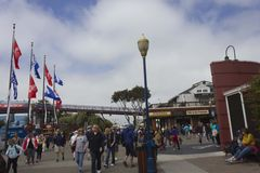 People walking along Pier 39 dock in San Francisco Stock Images