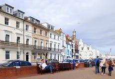 People walking along promenade at Eastbourne royalty free stock photos