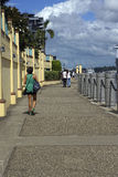 People walking along quay. The Brisbane riverside path at Portside Quay Stock Image