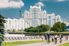 People walking along the the riverside promenade Royalty Free Stock Photos