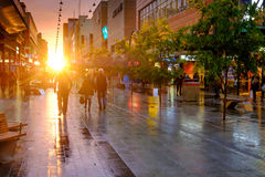 People walking along the Rundle Mall at sunset. Adelaide, Australia - September 30, 2016: People walking along the Rundle Mall in Adelaide CBD at sunset, viewing Royalty Free Stock Images