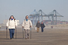 People walking along the seafront, Belgium Stock Image