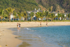 People are walking along seashore at five star Vinpearl resort Stock Photos