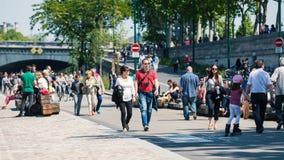 People walking along the Seine. PARIS, FRANCE - MAY 17, 2014: People walking along the Seine at daytime Royalty Free Stock Photos