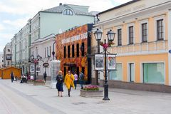 People walking along Stoleshnikov street in Moscow Royalty Free Stock Images