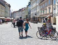 People walking along the street, Ljubljana, Slovenia. Walking people, many bikes standing along the street Royalty Free Stock Photo