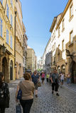 People walking along a street in the old city of Prague, near th Stock Photo