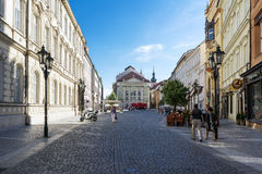 People walking along a street in the old city of Prague, near th Royalty Free Stock Image