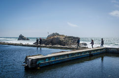 People walking along Sutro Baths ruins Royalty Free Stock Photo