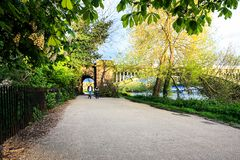 People walking along the Thames river in Richmond. UK. Richmond Railway Bridge, Thames River stock image