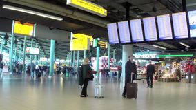 People walking in the Amsterdam Airport Schiphol stock video footage