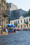 People are walking on the Andriyivskyy Descent. Kyiv, Ukraine. Podil. Editorial. 08.03.2017. People are walking on the Andriyivskyy Descent near new building of Royalty Free Stock Photography