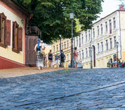 People are walking on the Andriyivskyy Descent in Kyiv, Ukraine. Podil. Editorial. 08.03.2017. People are walking on the Andriyivskyy Descent, pedestrian street Stock Photos