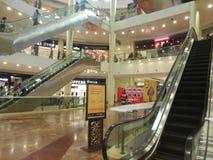 People are walking ans shopping at viviana mall, mumbai, india, 23rd September 2017. Escalator inside mall: People are walking ans shopping at viviana mall Stock Image