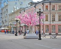 People walking by Arbat pedestrian shopping street, Moscow. MOSCOW, RUSSIA - MAY 02: People walking by Arbat pedestrian shopping street, Moscow on May 2, 2018 Stock Photography
