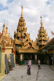 People walking in the area of the  Sule Paya Pagoda in Yangon Royalty Free Stock Photos