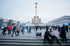People walking around the frosty occupying street during anti-government protest Euromaidan in Kiev, Ukraine. Stock Photo