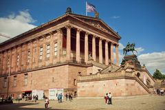 People walking around great structure of Alte Nationalgalerie, Berlin. Royalty Free Stock Image