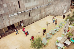 People walking around Museum of Modern Art with outdoor cafe in the Museumsquartier Stock Photography
